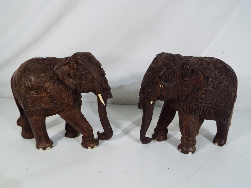Lot 33 - Two carved wooden models depicting elephants approx 15.