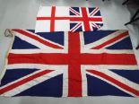 Lot 43 - A large Union Flag measuring approx 90cm x 175cm and two smaller flags (3)
