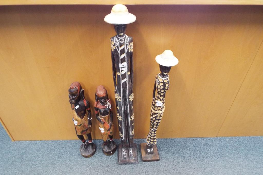 Lot 10 - Four hand carved wooden figures the largest being approx 105cm (h)