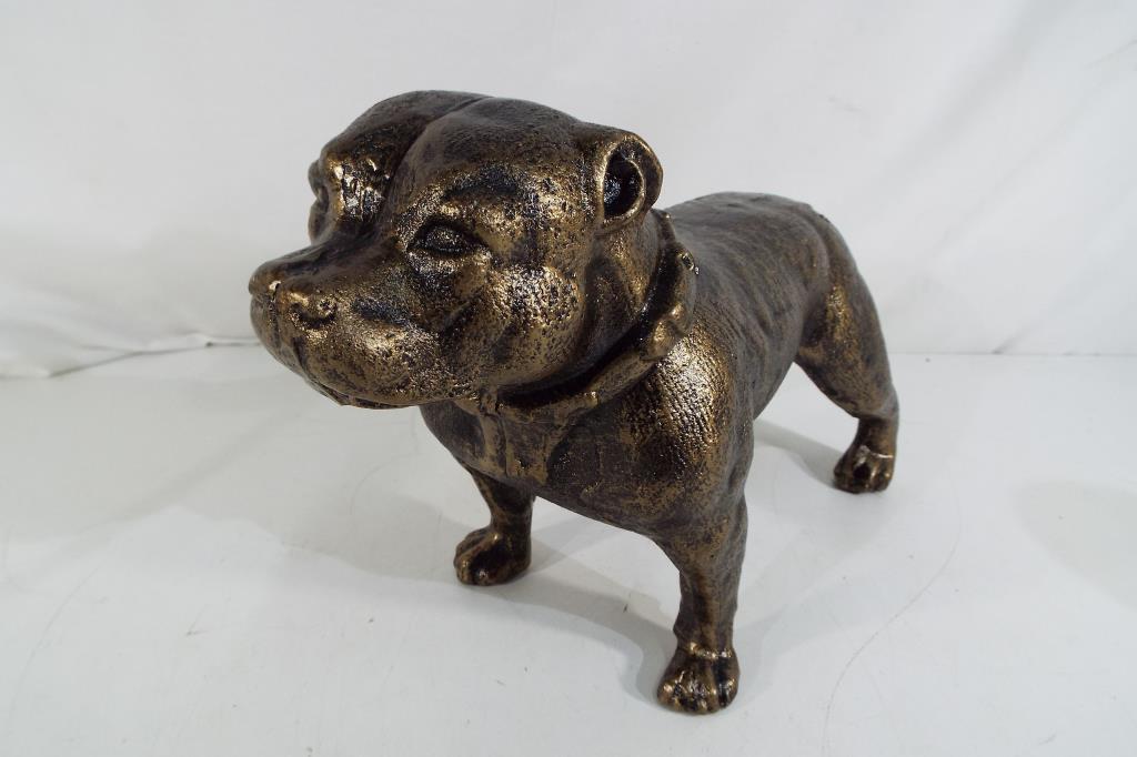 Lot 15 - A cast bronzed statue depicting a pit bull,