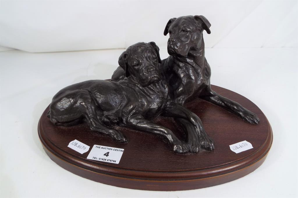 Lot 4 - A bronzed study depicting two dogs on wooden plinth cast signature Doris Lindner approx 14cm (h)
