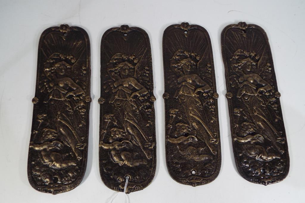 Lot 8 - Four large cast finger plates 28cm x 9cm Est £25 - £40