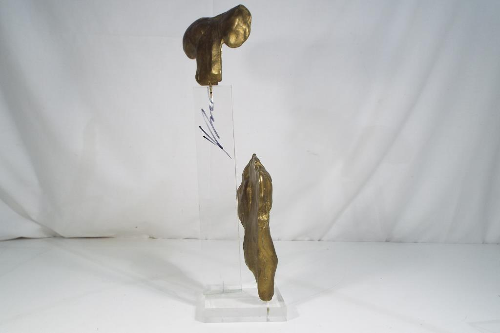 Lot 11 - An unusual brass sculpture on a perspex stand which is signed,