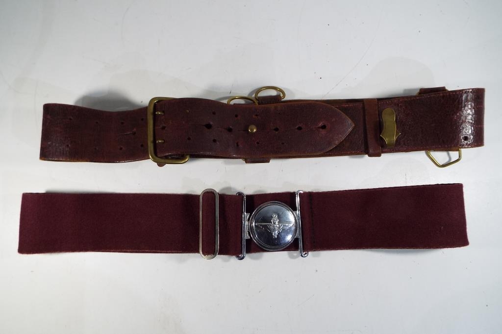 Lot 55 - A Parachute Regiment belt and buckle along with a further belt.
