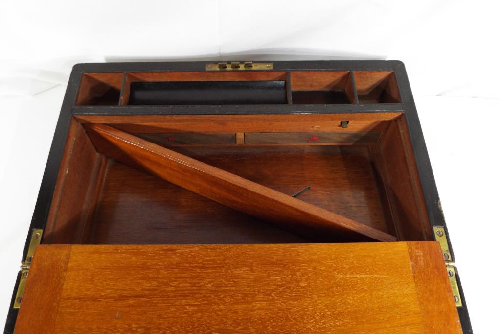 Lot 3 - A writing slope hinged lid with black leather writing surface with gilded details with brass mounts,