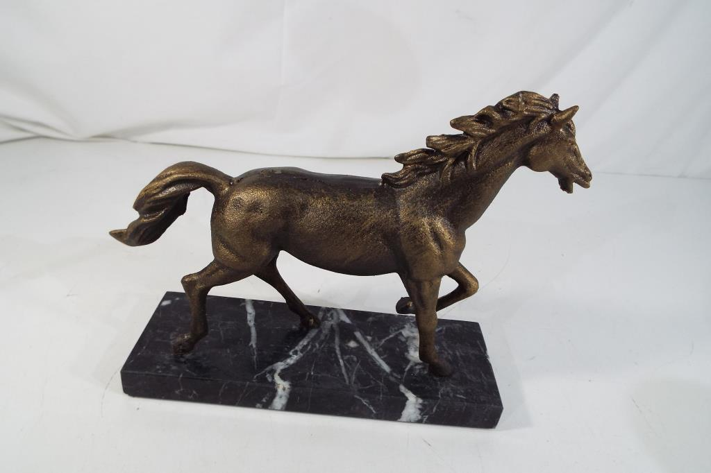 Lot 12 - A cast bronzed statue depicting a horse on a marble plinth height including plinth 18.5cms x 23.