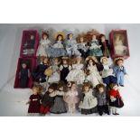 Lot 21 - Twenty three collectors cabinet ceramic dolls in varying costumes