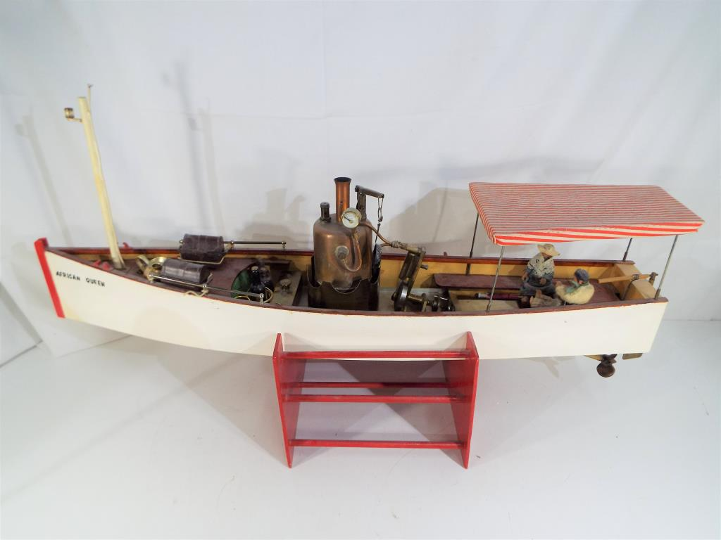Lot 25 - A scratch built steam powered pond yacht named African Queen on wooden stand approx 26cm x 73cm x
