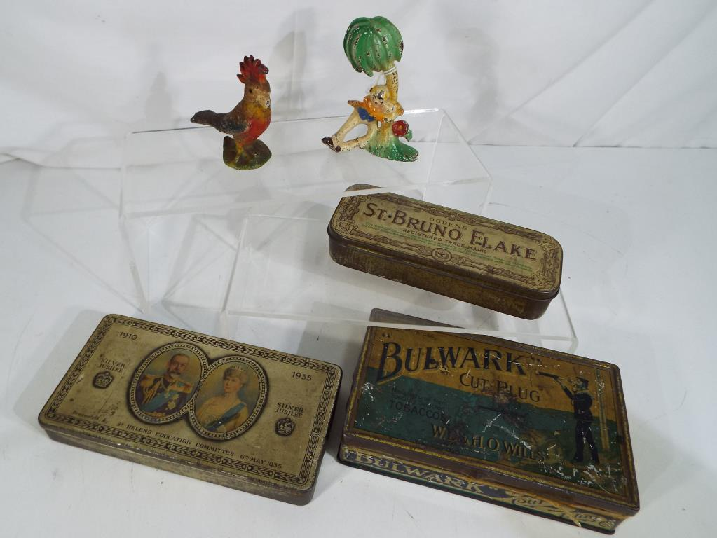 Lot 31 - Two American vintage novelty bottle openers and three vintage tins, Bulwark Cut Plug.