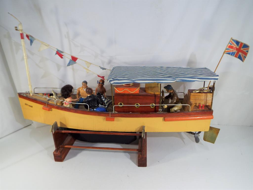 Lot 27 - A scratch built battery powered pond yacht (untested) named Skylark on a wooden stand approx 36cm x