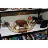 Lot 76 - Shelf of collectables including carved eagle, mounted horns, hand-painted ostrich eggs,