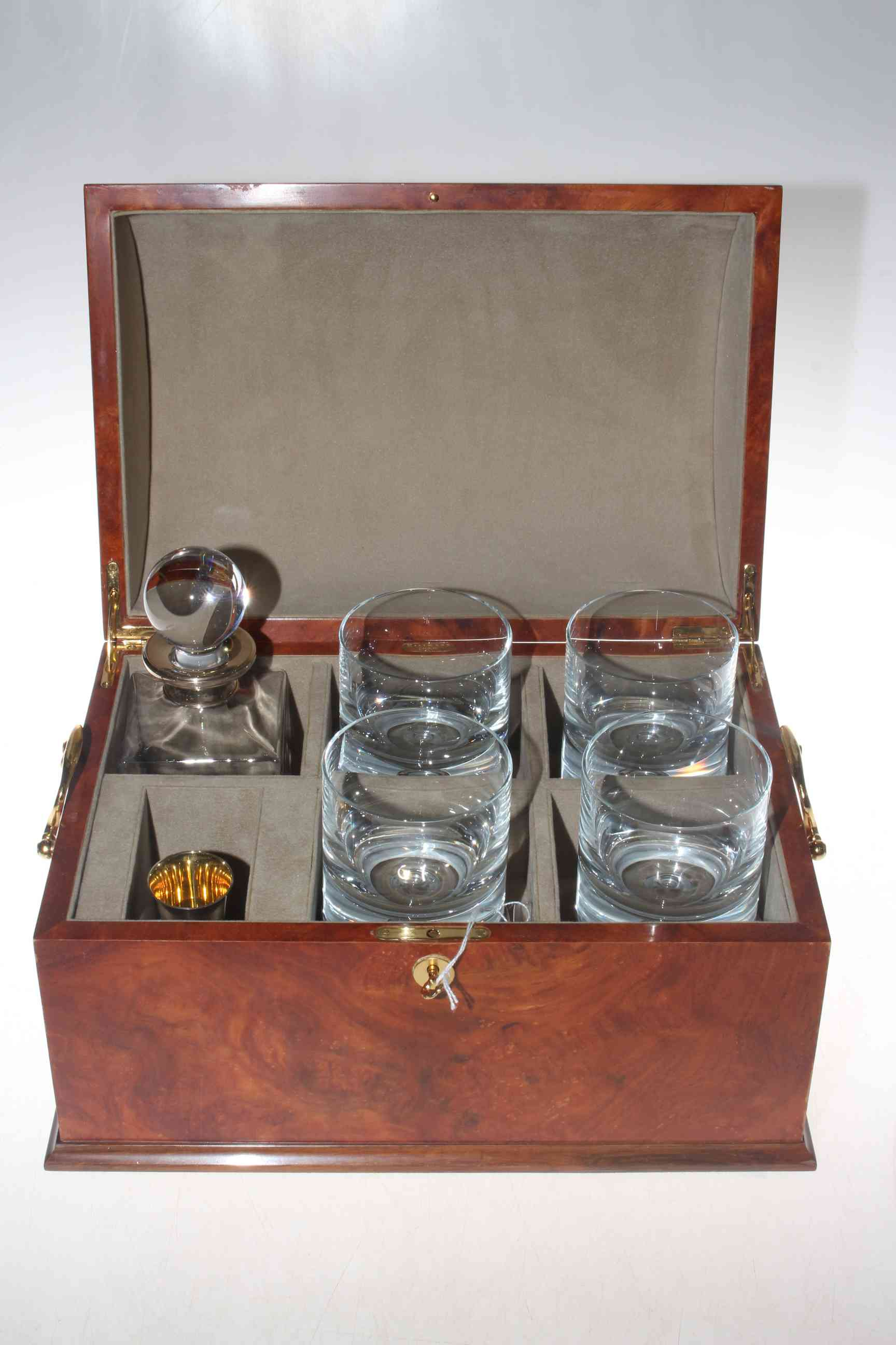Lot 304 - Silver mounted spirit decanter and tumbler set with solid silver measure and in burr woos