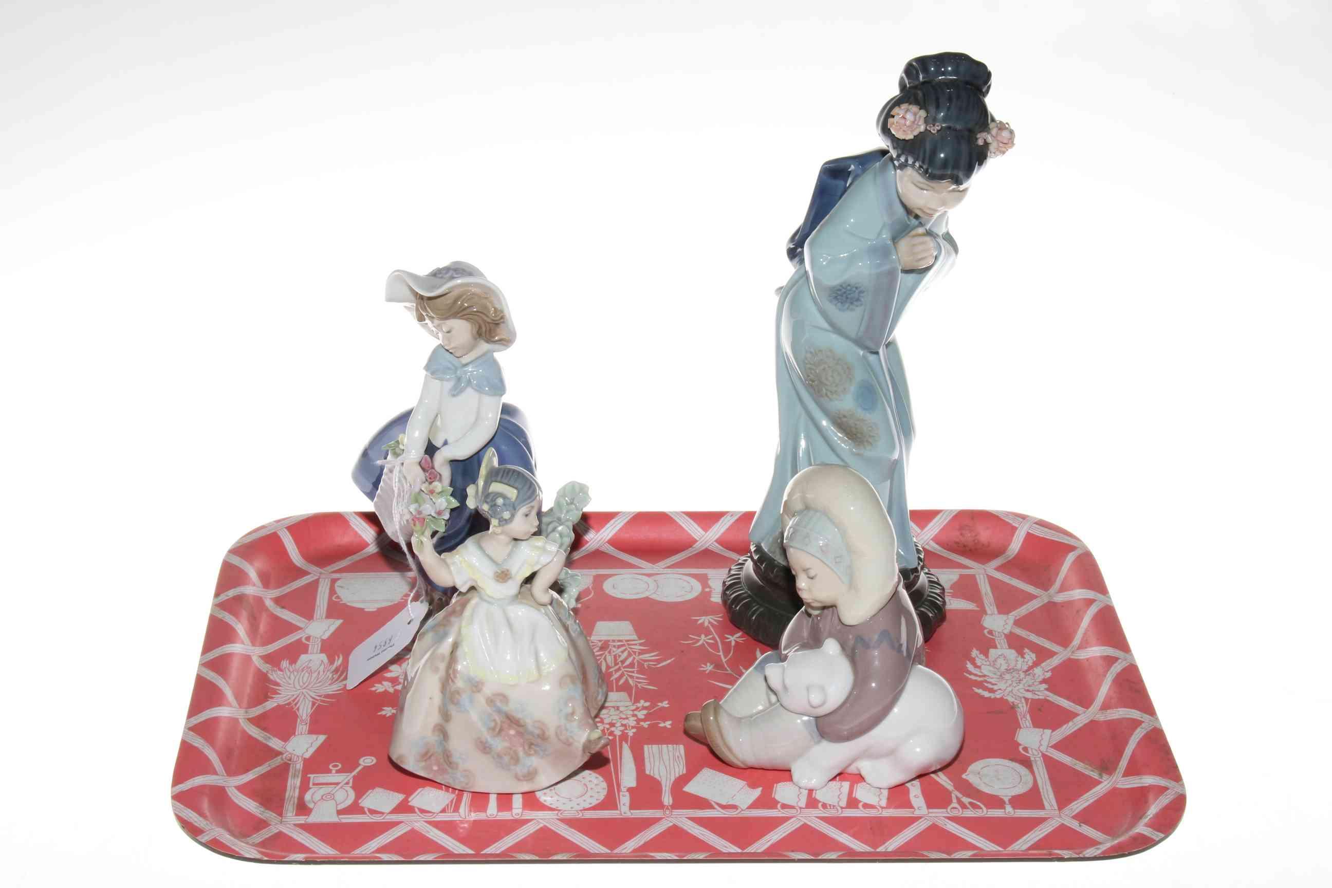 Lot 10 - Four Lladro figurines.