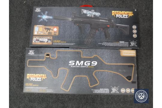 Two boxed Regimental Police water pellet SMG9 guns