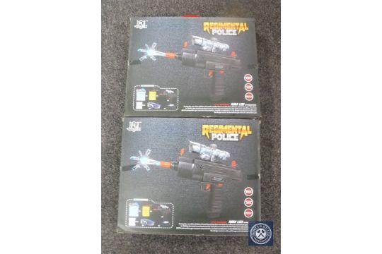 Two boxed Regimental Police water pellet mini uzi guns