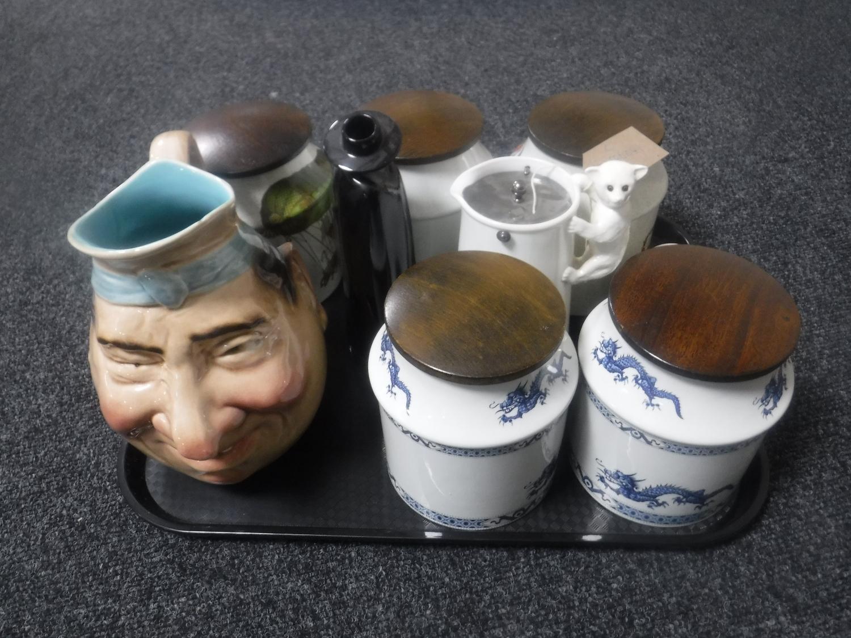 Lot 27 - A tray of five Ellgrave wooden lidded storage jars, large Sarreguemines pottery jug,