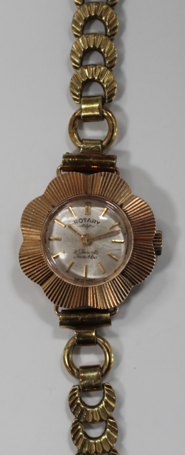 Lot 1003 - A Rotary 9ct gold flowerhead shape cased lady's wristwatch with an unsigned jewelled movement,