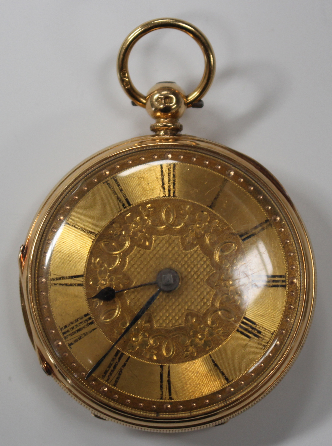 Lot 1048 - An 18ct gold cased keywind open-faced fob watch, the gilt movement detailed to the back plate 'Edwin