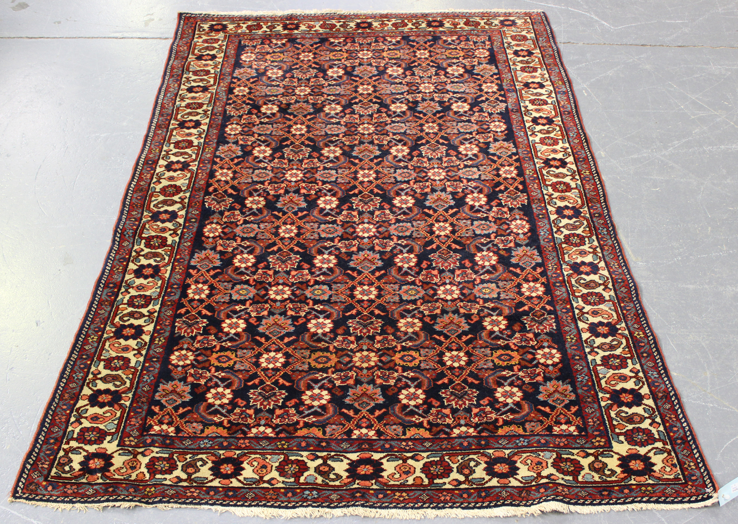 Lot 2902 - A Senneh rug, North-west Persia, early/mid-20th century, the ink blue field with an overall floral