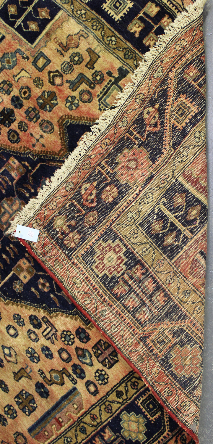 Lot 2926 - A Hamadan rug, North-west Persia, mid/late 20th century, the faded pink field with three linked