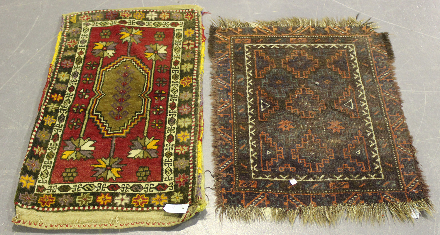 Lot 2921 - A Beluche rug, Afghan/Persian borders, mid-20th century, the flatweave field with overall