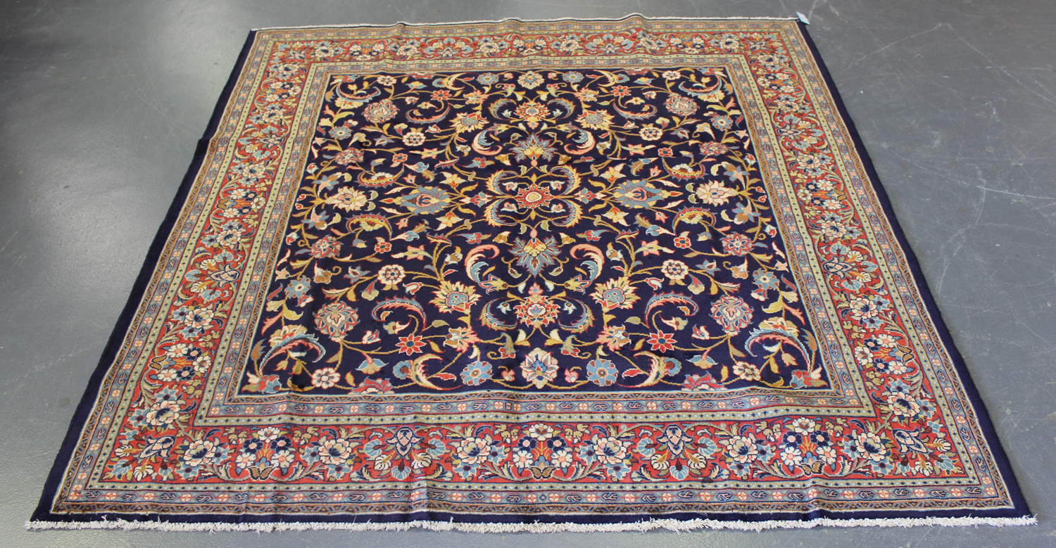 Lot 2908 - An Arak square rug, North-west Persia, mid/late 20th century, the midnight blue field with overall