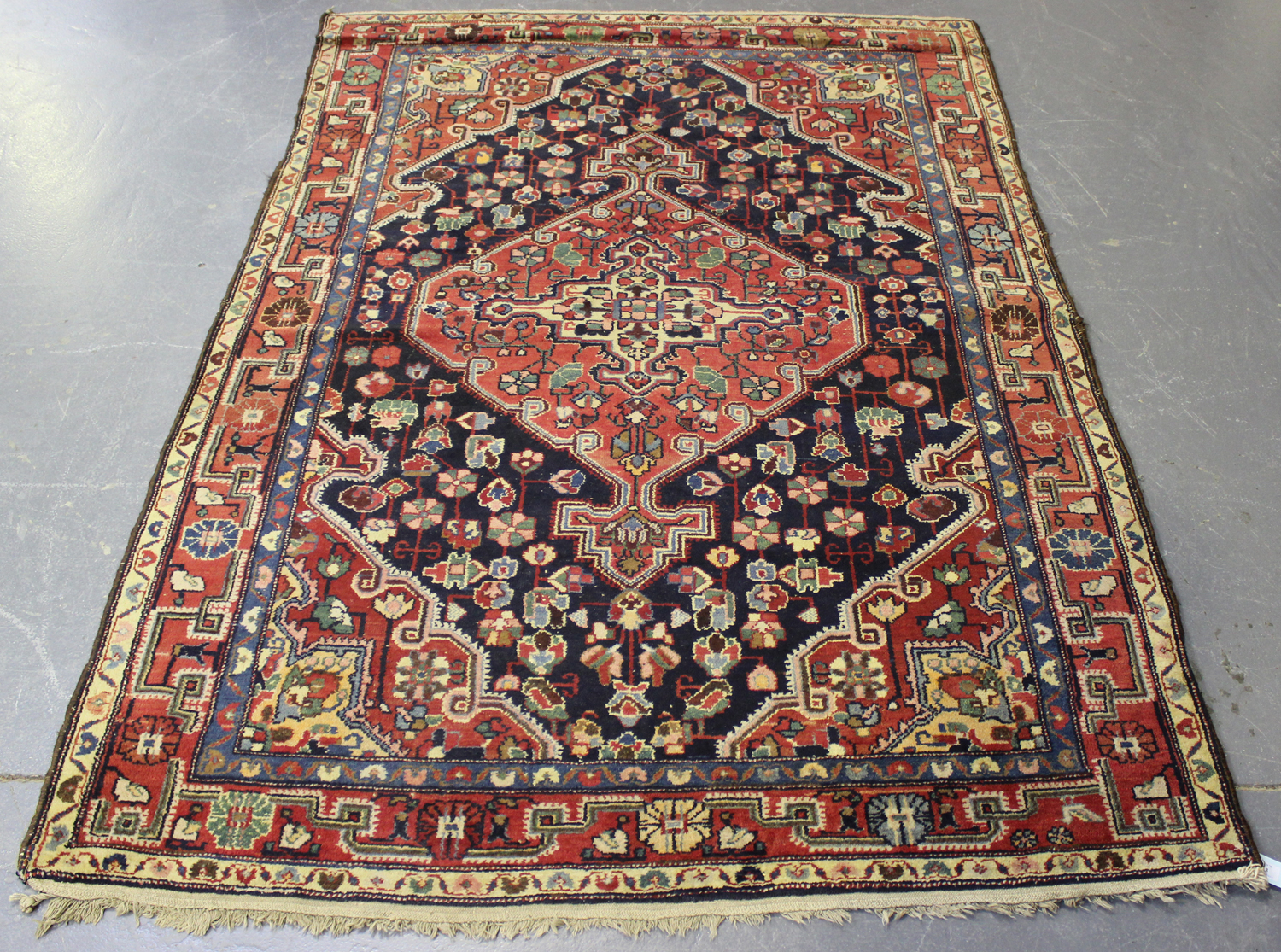 Lot 2913 - A Hamadan rug, North-west Persia, early/mid-20th century, the charcoal field with a red lozenge