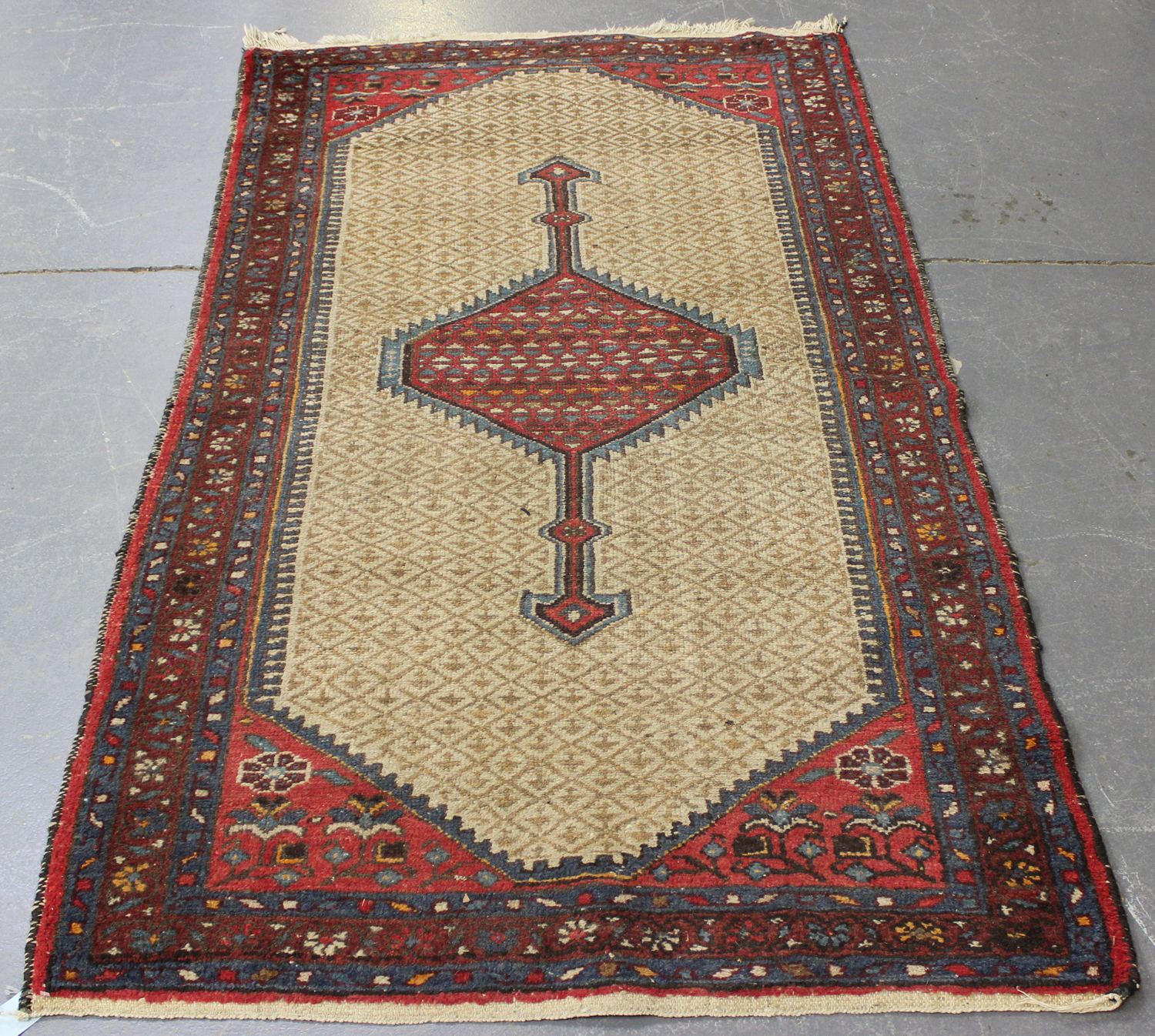 Lot 2909 - A Hamadan rug, North-west Persia, early 20th century, the ivory lattice field with a pole medallion,