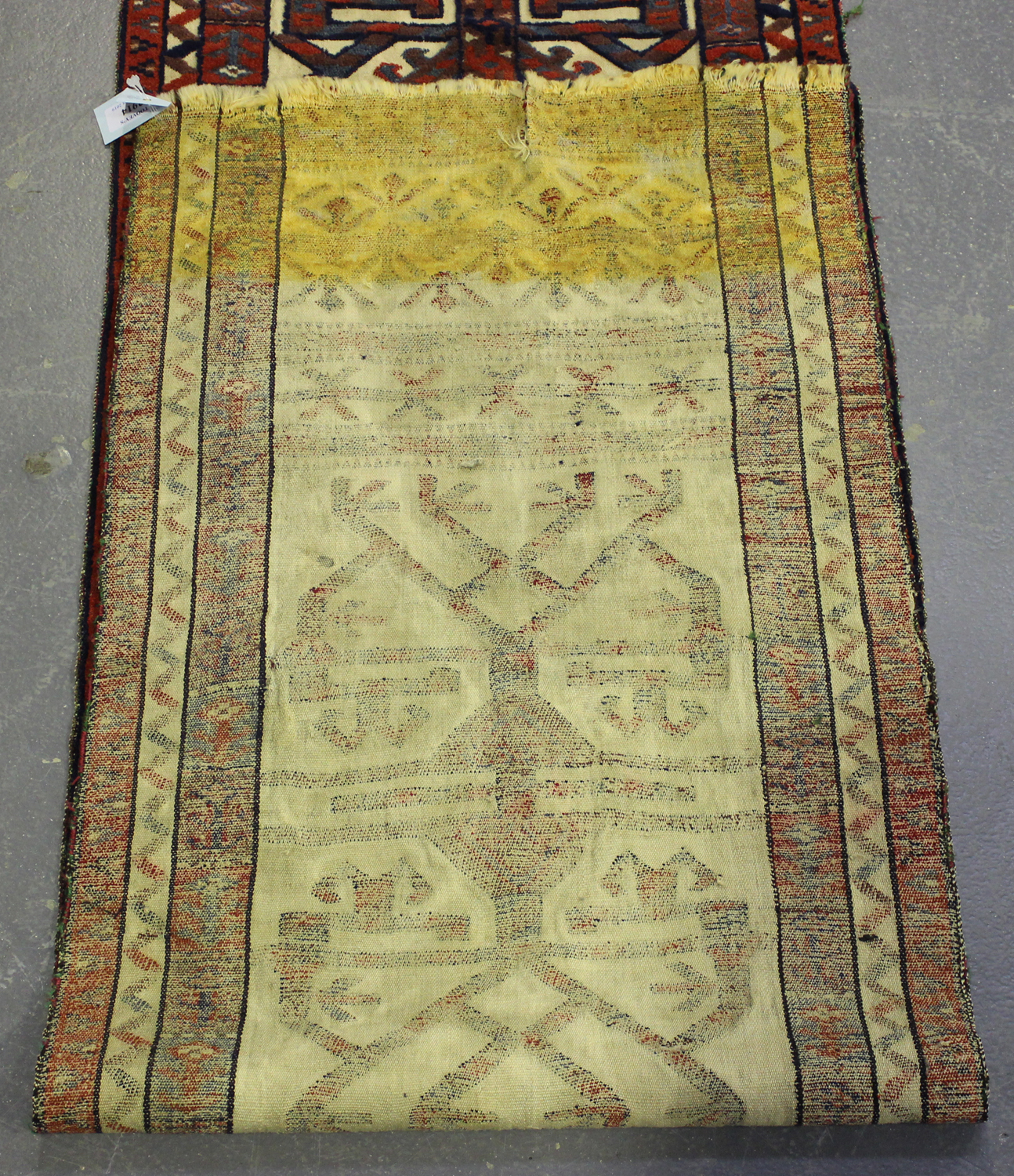 Lot 2914 - A Turkestan tent band, early/mid-20th century, the ivory flatweave ground with continuous