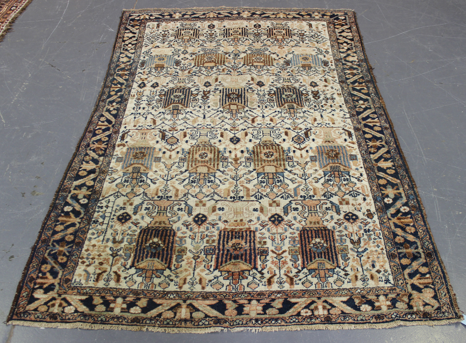 Lot 2915 - A Malayer rug, North-west Persia, mid-20th century, the ivory field with overall offset rows of