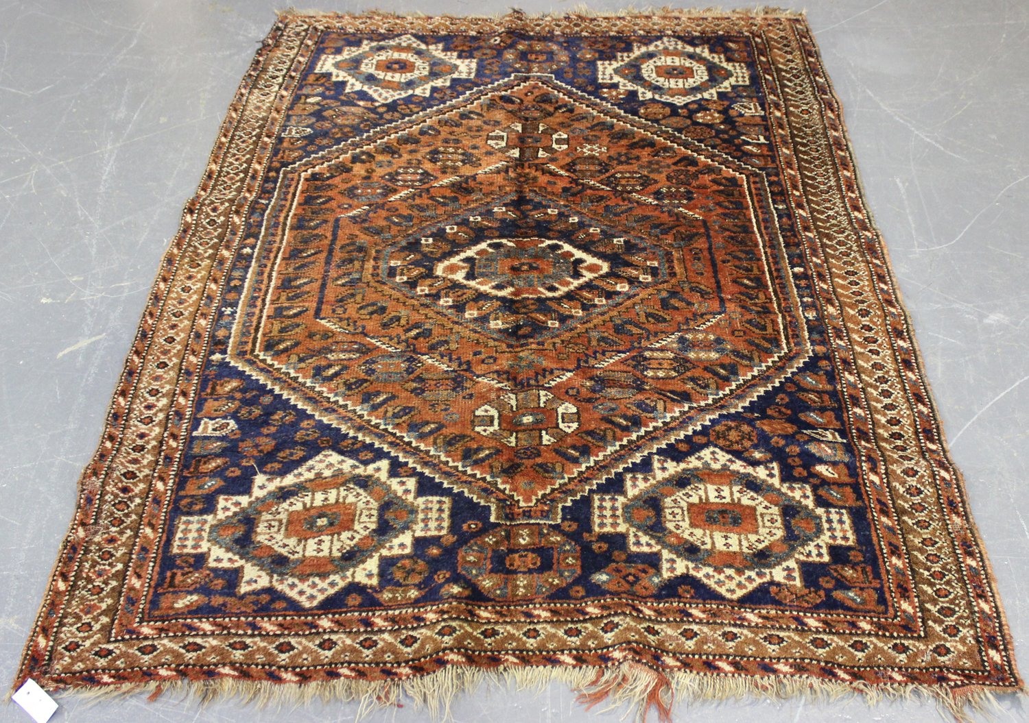 Lot 2907 - A Shiraz rug, South-west Persia, early 20th century, the red field with a lozenge medallion,