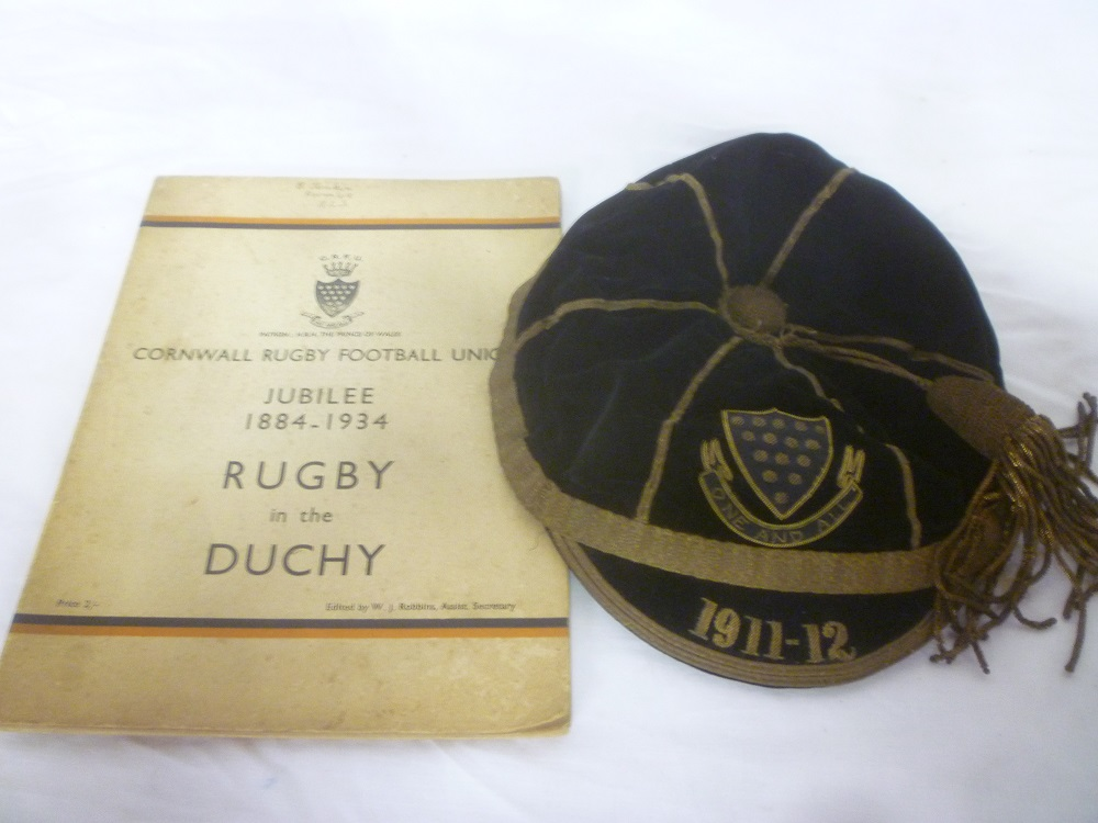 Lot 646 - A Cornwall Rugby Union black velvet and gold bullion cap for the 1911/ 1912 season worn by C