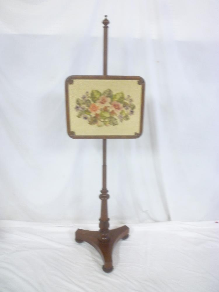 Lot 642 - A 19th mahogany pole screen with floral tapestry rectangular panel on tripod base