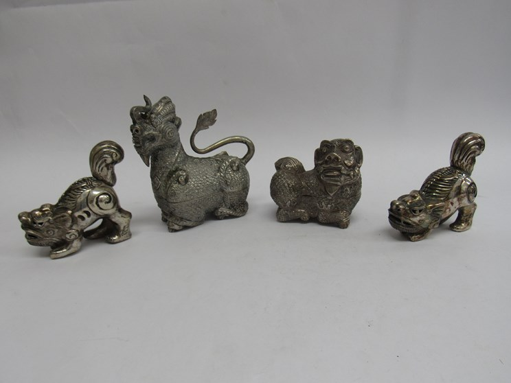 Lot 6282 - Four Cambodian white metal dragon dog form trinket pots