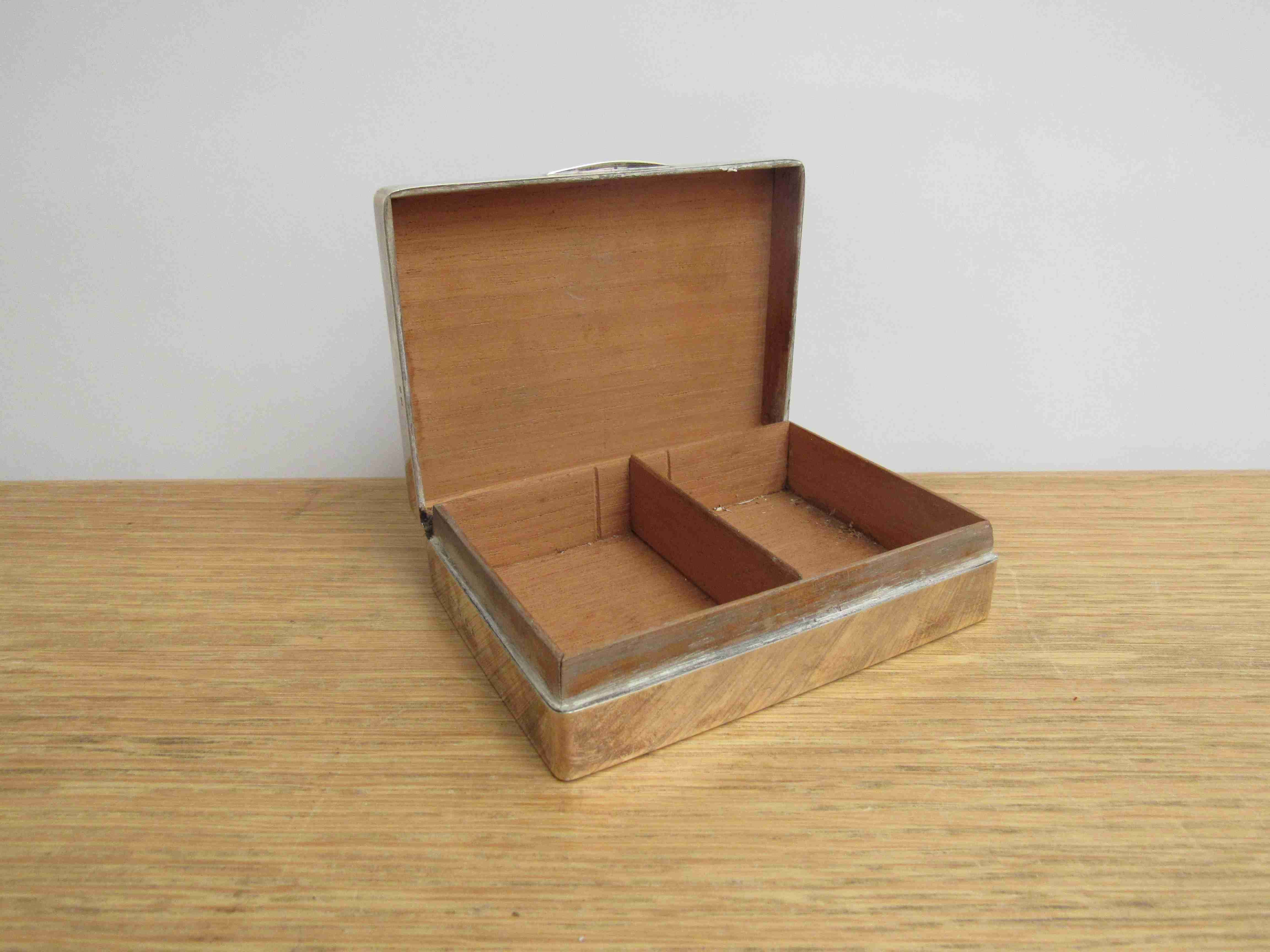 Lot 17 - A silver cigarette box of plain form with engine - turned lid, Birmingham 1911, 3.