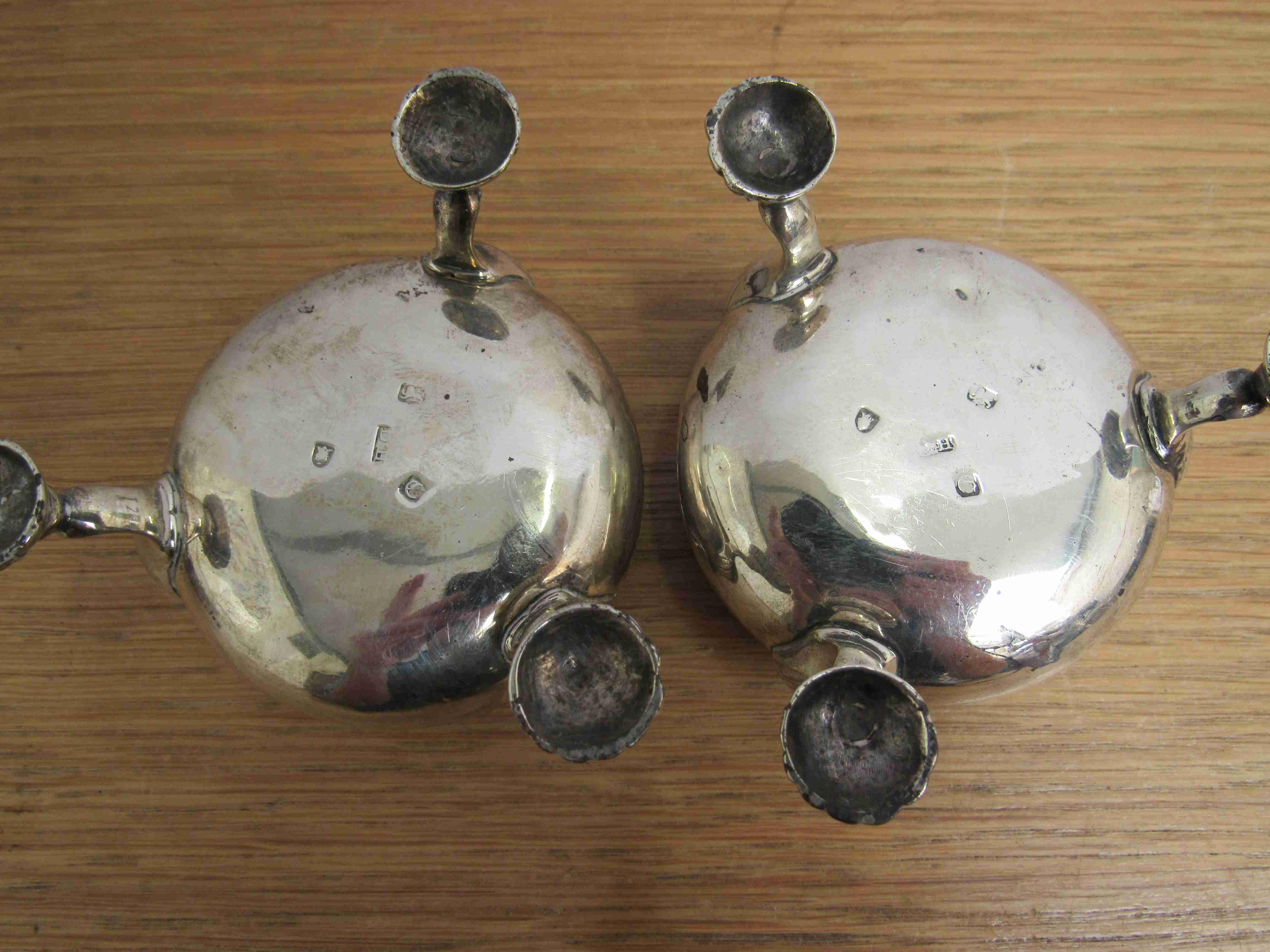 Lot 6 - A pair of George III Daniel Hockley silver salts raised on three feet, London 1762,