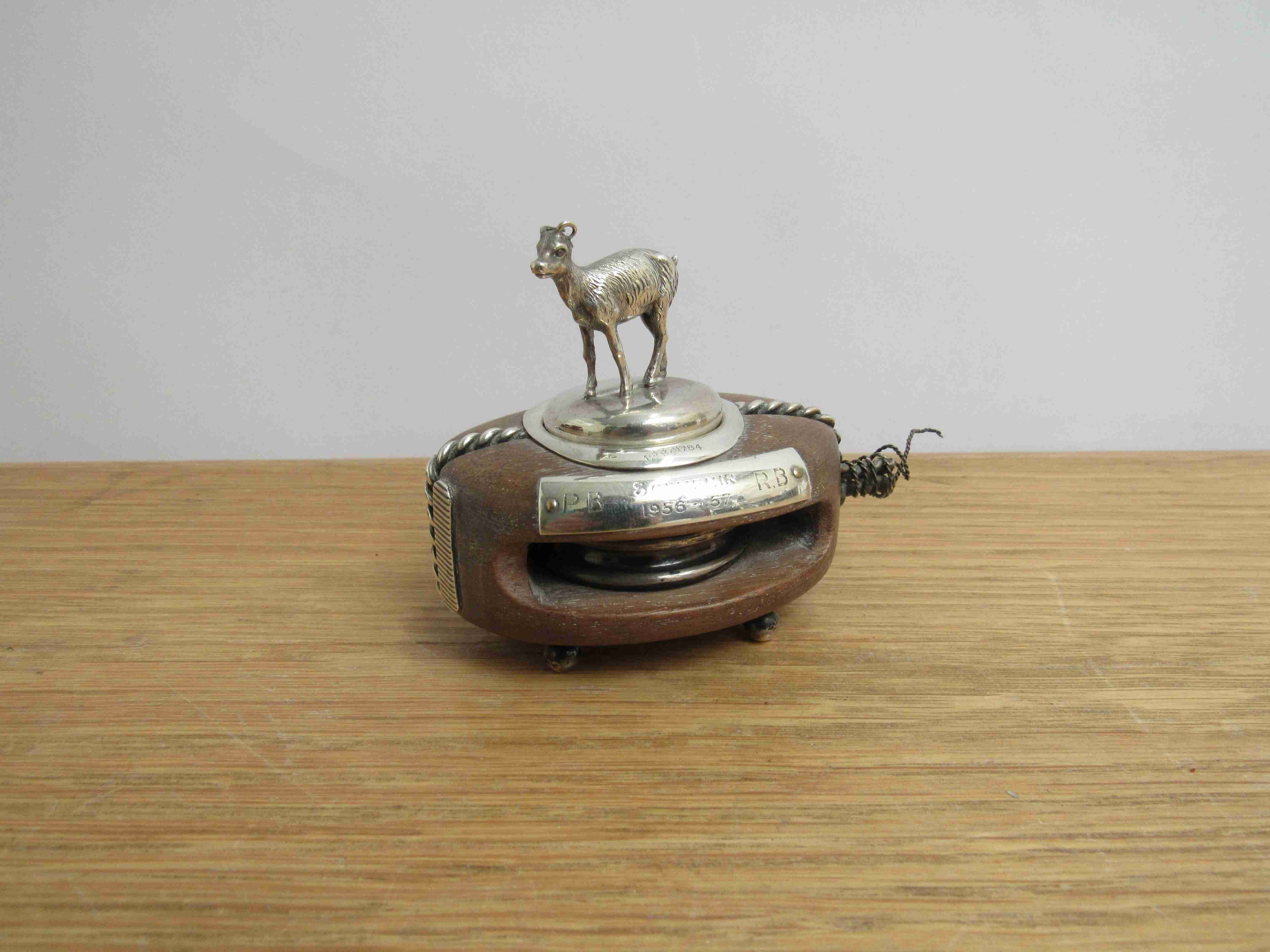 Lot 22 - A Lawrence Emanuel novelty silver mounted hardwood boat pulley - match striker with a deer wine