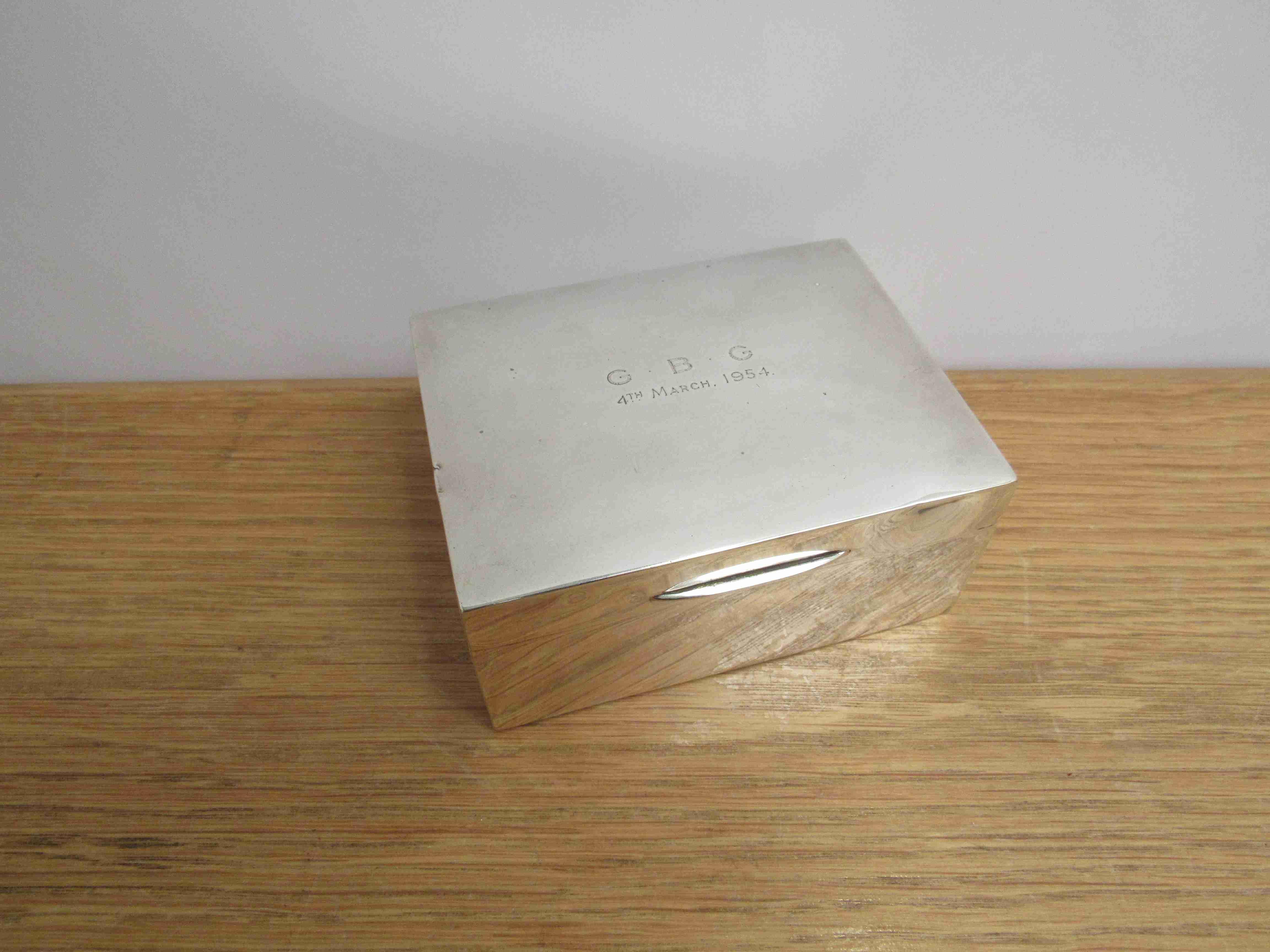 Lot 18 - A William Neale & Son Ltd silver cigarette box, plain form with engraved lid, Birmingham 1953.