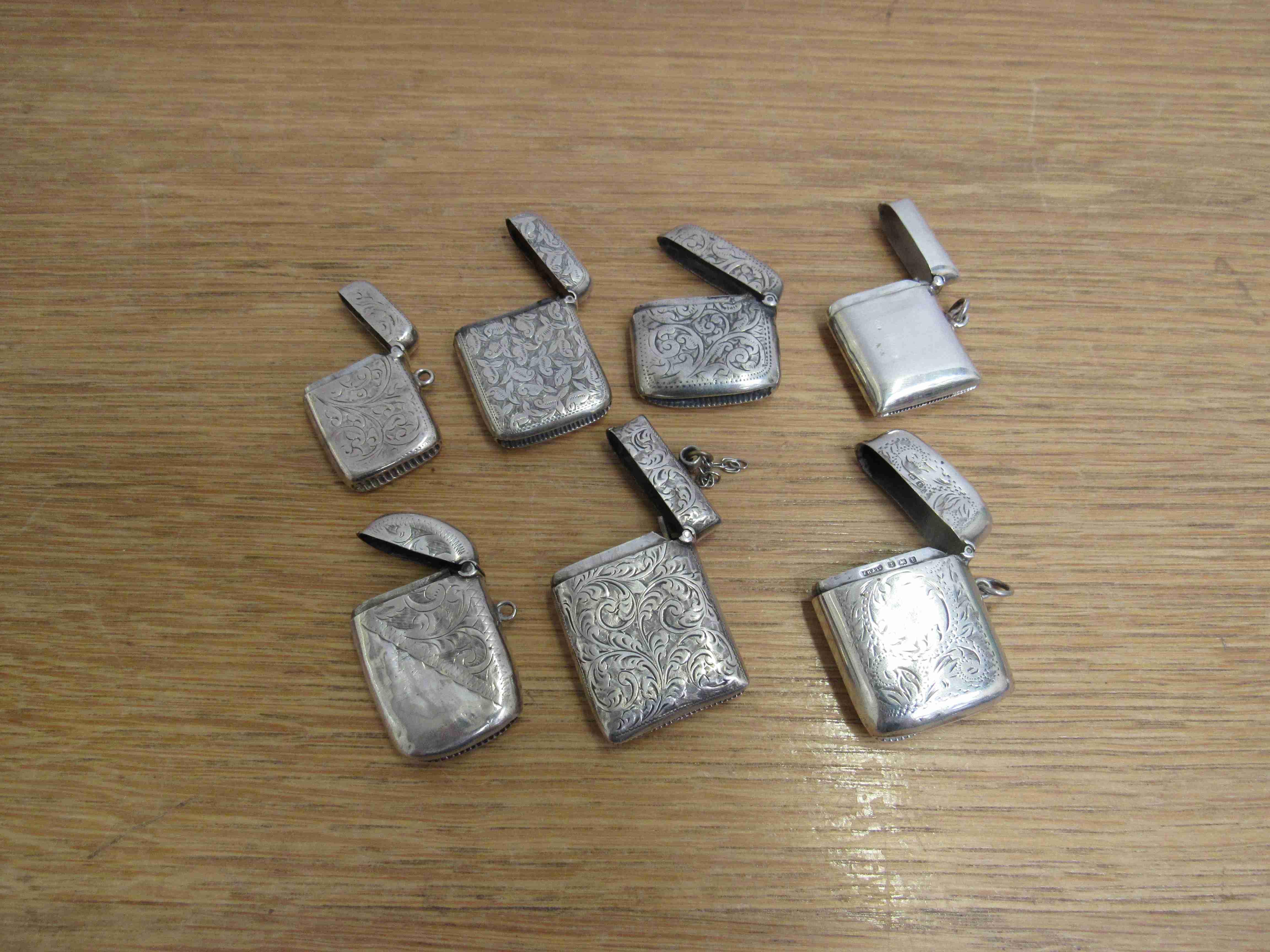 Lot 60 - Seven silver vestas one marked sterling 117g