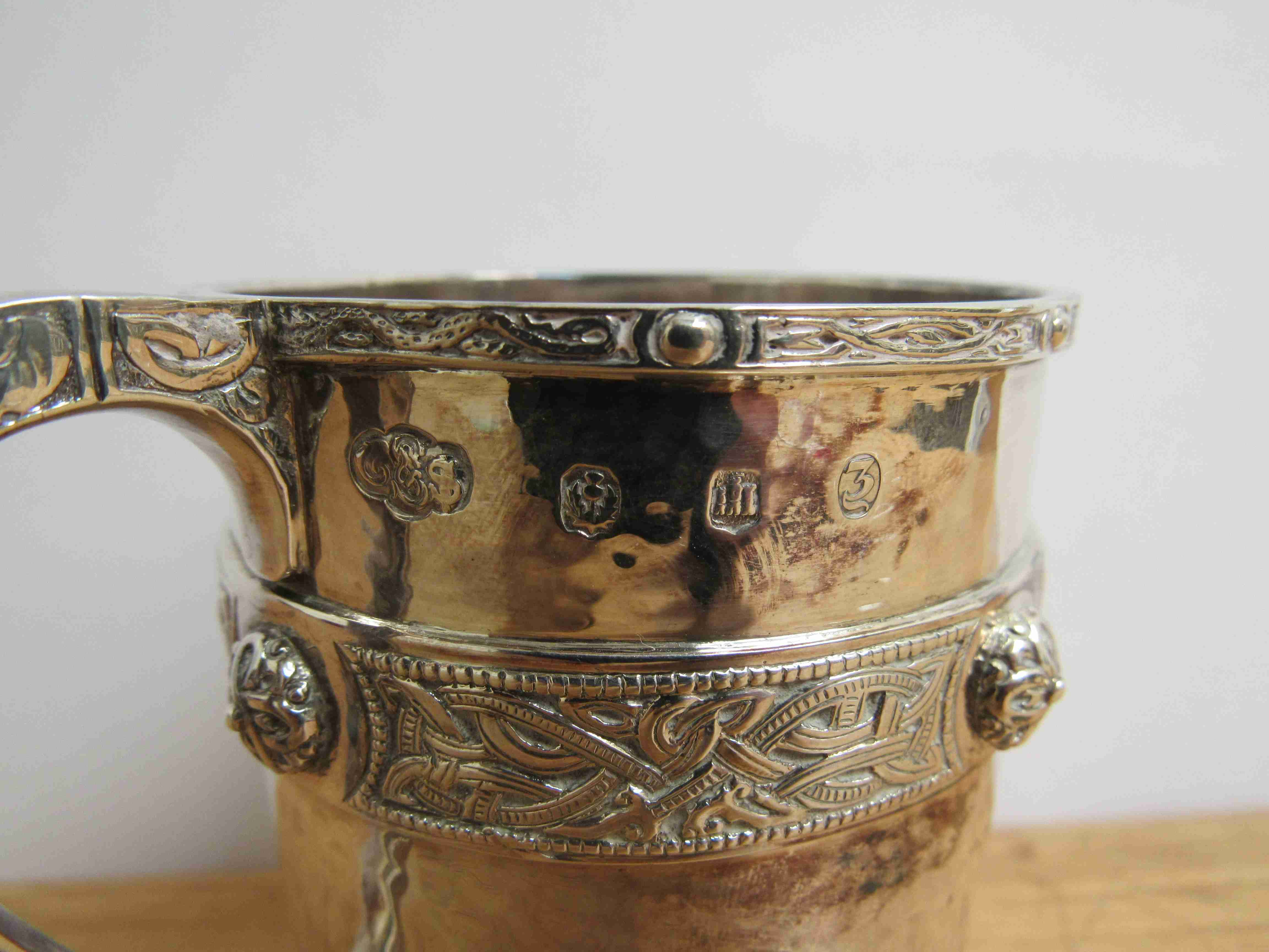 Lot 40 - A Thomas Smith & Sons, Edinburgh silver Celtic design tankard with ornate band, hammered body, 1905,