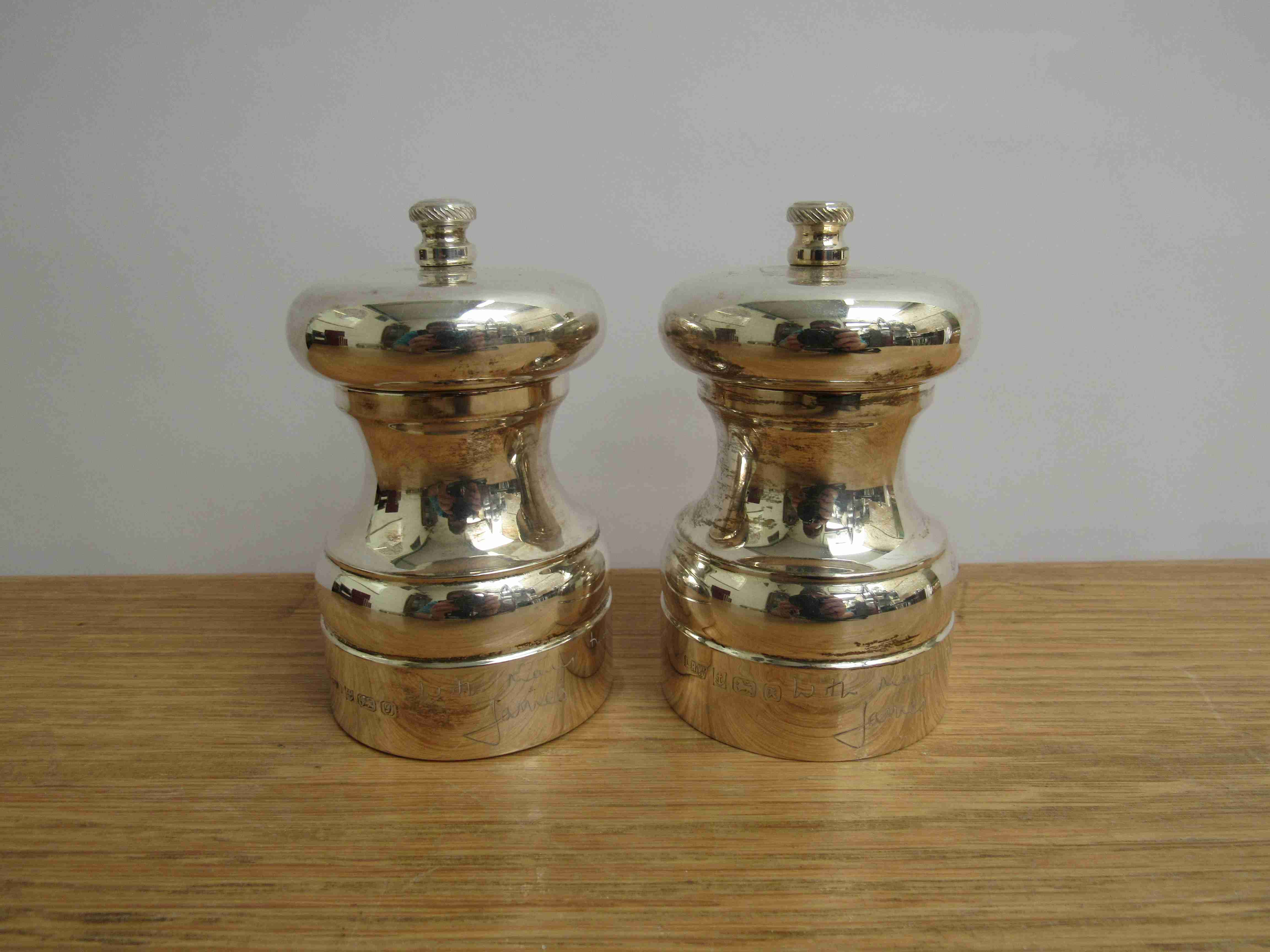 Lot 11 - A pair of Lawrence R Watson & Co silver salt and pepper grinders,