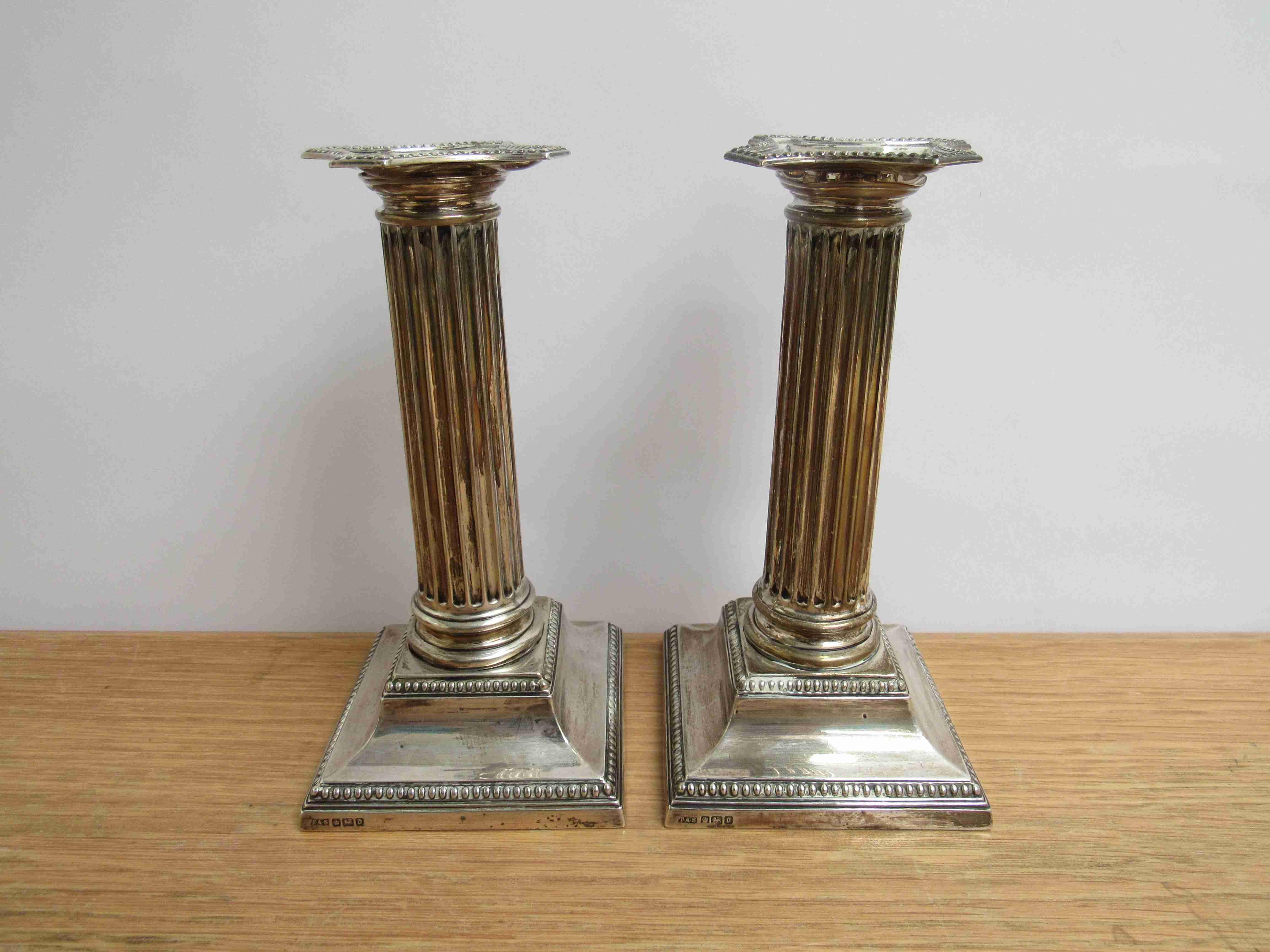 Lot 28 - A pair of Edwardian Thomas A Scott silver column candlesticks.