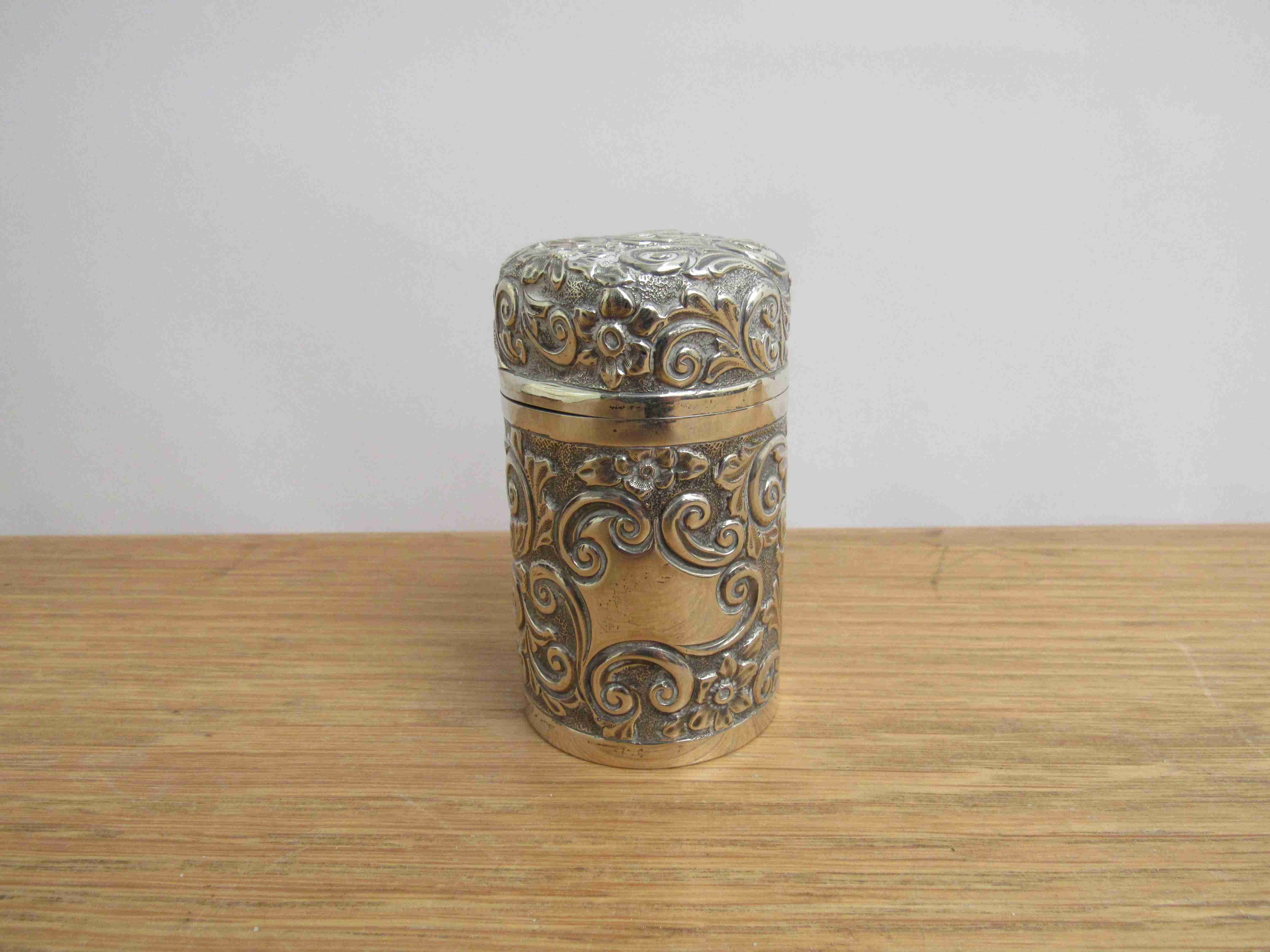 Lot 8 - An Arthur Willmore Pennington floral embossed silver scent bottle, slight dents,