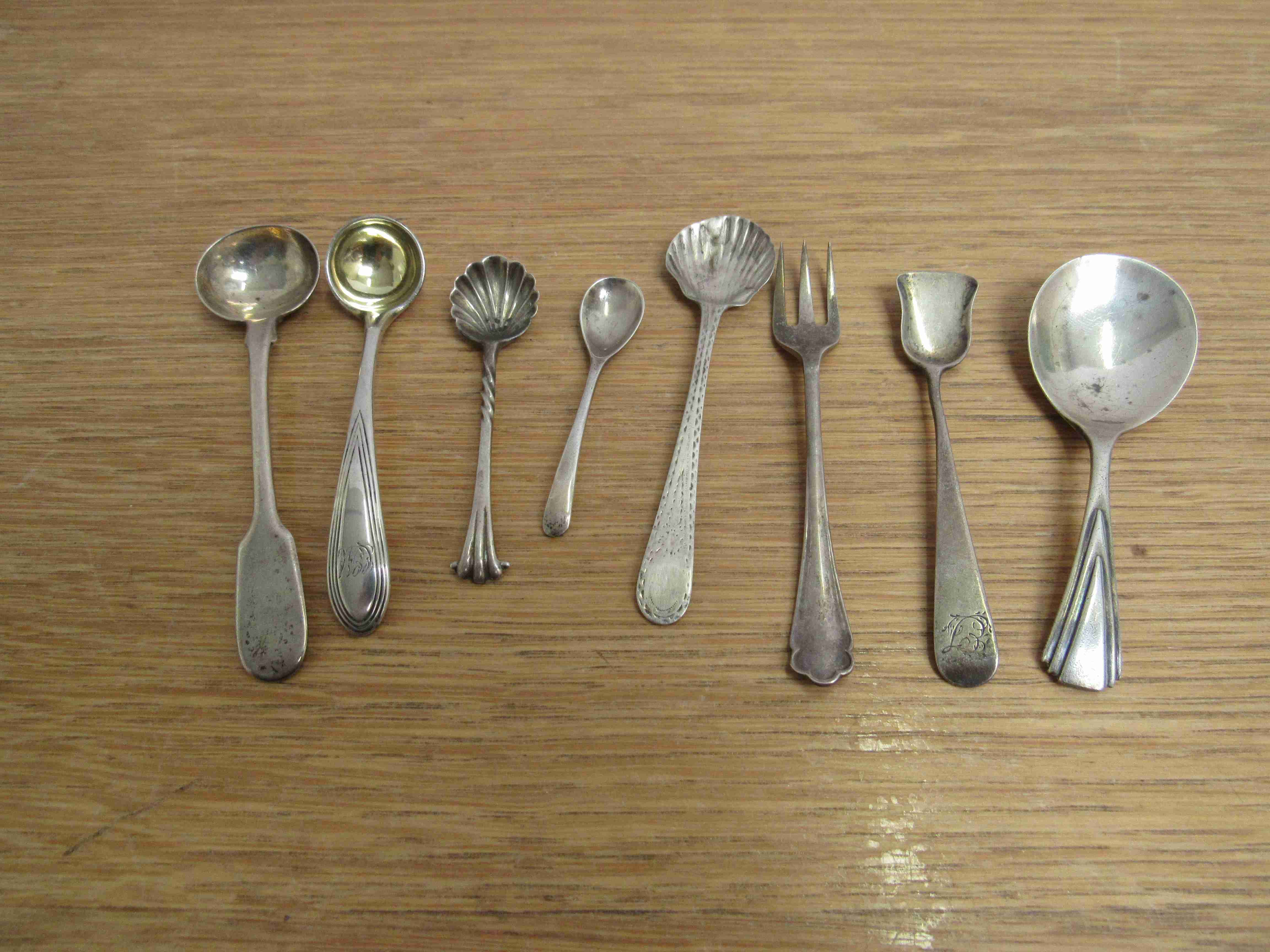 Lot 50 - Seven silver various condiment spoons and a fork (8) various makers and dates,