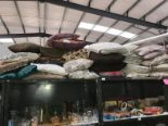Lot 9 - A large quantity of cushions (some singles,