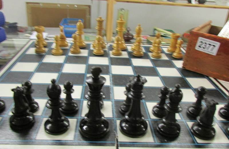Lot 2377 - A Chess set and a cribbage board.