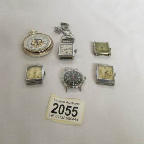 Lot 2055 - 4 'Deco' watch heads, a Timex watch head and a contemporary pocket watch.