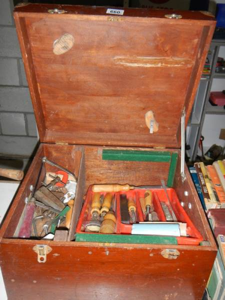 Lot 660 - A wooden box of tools including wood chisels, plane, clamps etc.