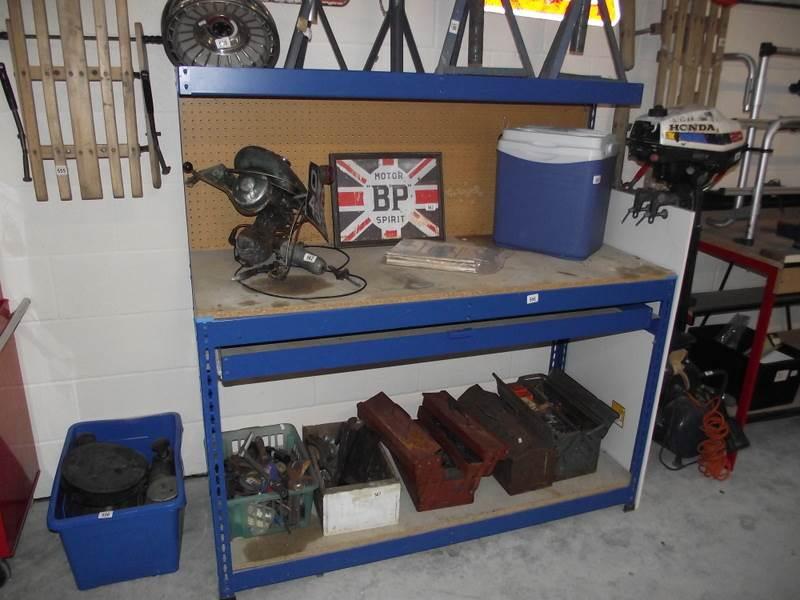 Lot 566 - A metal framed work bench.
