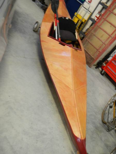 Lot 730 - A fibreglass reinforced plywood leisure canoe with paddles.